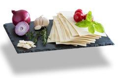 Preparing cooking italian food pasta lasagne bolognese ingredients Royalty Free Stock Photography
