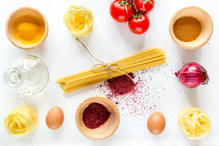 Preparing for cooking italian pasta white background top view Stock Images