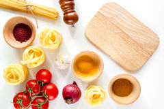 Preparing for cooking italian pasta white background top view mock up Royalty Free Stock Photos