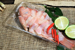 Preparing for cooking Thai spicy and sour soup with the fish, Thai Language is Tom Yum Pha. As background Stock Photos