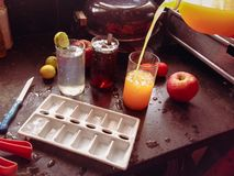 Preparing cool drinks. Preparing fresh fruits cool drinks for summer hot stock photo