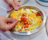 Preparing corn salad Stock Images
