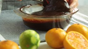 Preparing cream for chocolate mousse with orange jelly stock footage