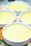 Preparing creme brulee Royalty Free Stock Photos