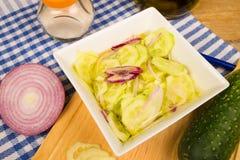 Preparing a cucumber salad Royalty Free Stock Images