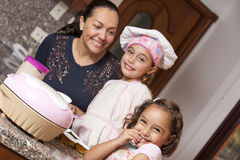 Preparing cupcakes with mom Royalty Free Stock Photo