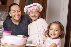 Preparing cupcakes with mom Royalty Free Stock Photos