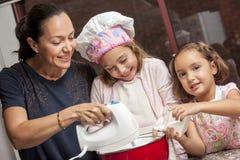 Preparing cupcakes with mom Stock Photos
