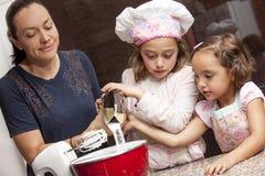 Preparing cupcakes with mom Stock Image