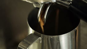 Preparing cups of espresso at a busy coffee shop stock video footage