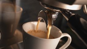 Coffee machine preparing cup of coffee. Coffee pouring into cup. stock video footage