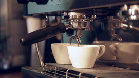Preparing cups of espresso at a coffee shop stock video footage