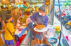 Preparing of deep fried chicken, Talad Saphan Phut market, Bangkok, Thailand