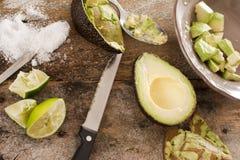 Preparing a delicious fresh avocado salad Stock Photos