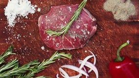 Preparing delicious raw steak for barbecue. stock video