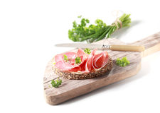 Preparing a delicious salami sandwich Royalty Free Stock Photography