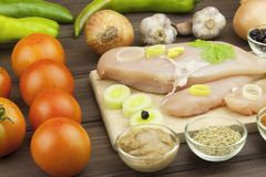 Preparing Diet food. Fresh raw chicken fillet and vegetables prepared for cooking. Fresh raw chicken breasts. Stock Photography