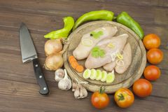 Preparing Diet food. Fresh raw chicken fillet and vegetables prepared for cooking. Fresh raw chicken breasts. Stock Photos