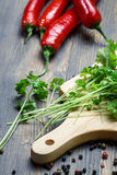 Preparing for dishes made ​​with parsley and red pepper Stock Image