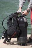 Preparing for dive. Assembling scuba gear Stock Images