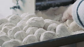 Preparing dough for baking rolls stock footage