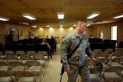 Preparing for Easter service in Afghanistan. US and Czech soldiers gathering for an Easter service in Logar Province, Afghanistan, April 2009 Royalty Free Stock Photography