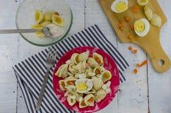 Preparing egg pasta salad Royalty Free Stock Photos