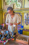 Preparing Ethiopian coffee in traditional boiling pot. KIEV, UKRAINE - JUNE 4, 2017: The master of traditional Ethiopian coffee ceremony pours the coffee from Royalty Free Stock Images