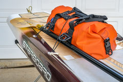 Preparing expedition stand up paddleboard for a trip. Fort Collins, CO, USA - August 1, 2017: Preparing for a paddling expedition in a driveway - waterproof stock photography