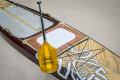 Preparing expedition stand up paddleboard for a trip. Fort Collins, CO, USA - July 29, 2017: Preparing for a paddling expedition in a driveway - Starboard royalty free stock image