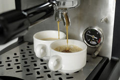 Preparing expressos with a expresso machine. Food , drinks, beverages,cookery stock image