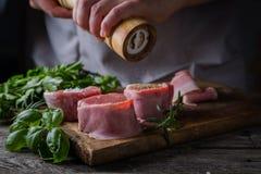 Preparing filet mignon - hands seasoning the steak Stock Photo