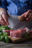 Preparing filet mignon - hands seasoning the steak Royalty Free Stock Photography