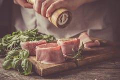 Preparing filet mignon - hands seasoning the steak Stock Photography