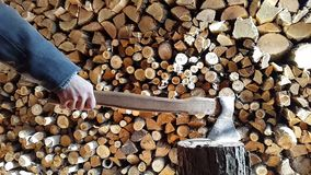 Preparing firewood,chopping wood with an ax. stock video footage