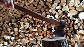 Preparing firewood,chopping wood with an ax. 60fps. stock video