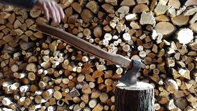 Preparing firewood,chopping wood with an ax.logo stock video