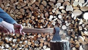 Preparing firewood,chopping wood with an ax.Slow motion stock footage