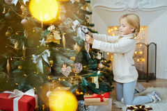 Preparing firtree for xmas Stock Images