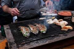 Frying of fishes royalty free stock image