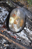 Preparing fish soup on the fire during the trip. Stock Photo