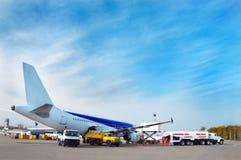 Preparing for flight. Airliner's technical service at airfield, preparing for flight Stock Image