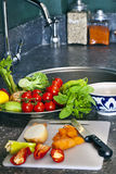 Preparing food. And vegetables for a salad royalty free stock images