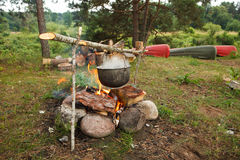 Preparing food on campfire. In wild camping Royalty Free Stock Photo