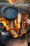 Preparing food on campfire. In wild camping Stock Photography