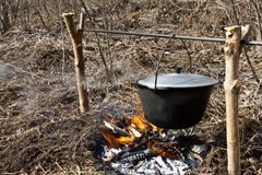 Preparing food on campfire. Cooking on an open fire Royalty Free Stock Photos