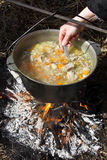 Preparing food on campfire. Cooking on an open fire Royalty Free Stock Images