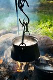 Preparing food on campfire. In boiler Royalty Free Stock Photo