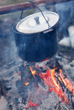 Preparing food on campfire. Closeup Royalty Free Stock Image