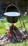 Preparing food on campfire Stock Images